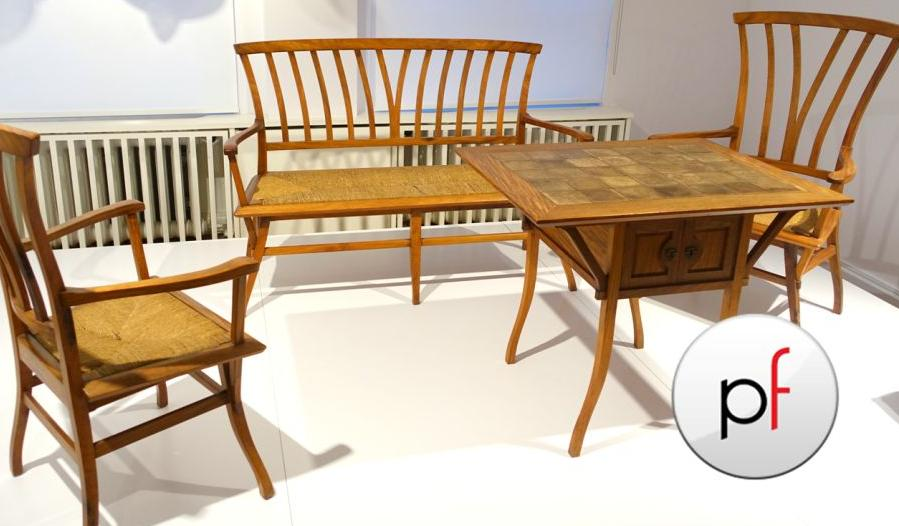 https://upload.wikimedia.org/wikipedia/commons/7/71/Furniture_from_the_Bloemenwerf_House%2C_Henry_van_de_Velde%2C_1895%2C_bubinga_wood%2C_cane%2C_ceramic_-_Br%C3%B6han_Museum%2C_Berlin_-_DSC03980.JPG